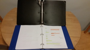 Old black script binder vs. new blue script binder